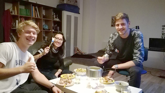 Swiss cheese fondue evening in the trainee flatshare